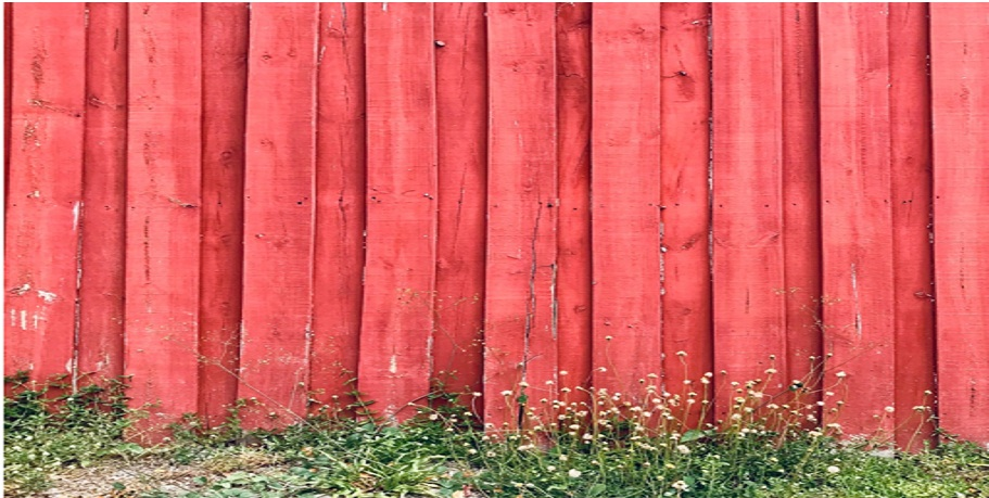 Install a wooden fence